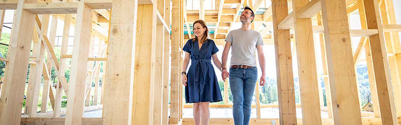 couple in new build home